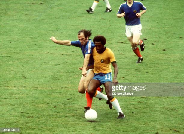 Tackle between Brazilian midfielder Paulo Cesaar Lima and Yugoslavian midfielder Branco Oblak Titleholder Brazil and Yugoslavia play a 00 tie at the...