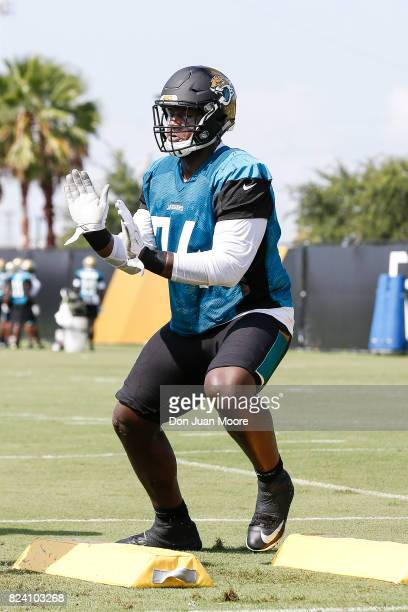 Tackle Cam Robinson of the Jacksonville Jaguars works out during Training Camp at Florida Blue Health and Wellness Practice Fields on July 28 2017 in...