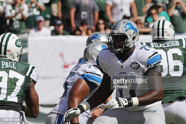 Tackle Cornelius Lucas of the Detroit Lions blocks against the New York Jets at MetLife Stadium on September 28 2014 in East Rutherford New Jersey