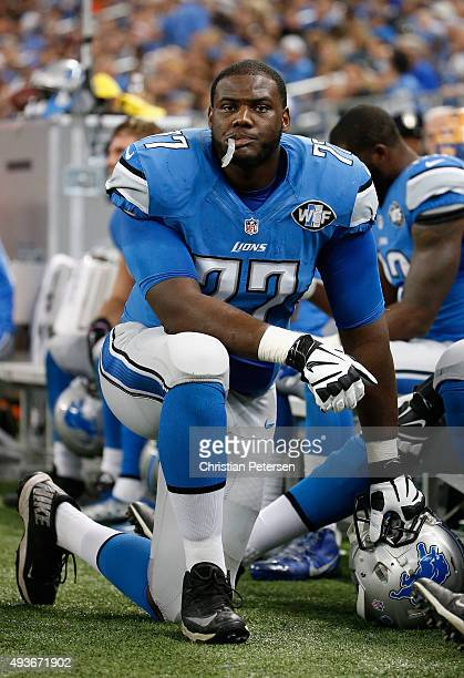 Tackle Cornelius Lucas of the Detroit Lions on the sidelines during the NFL game against the Chicago Bears at Ford Field on October 18 2015 in...