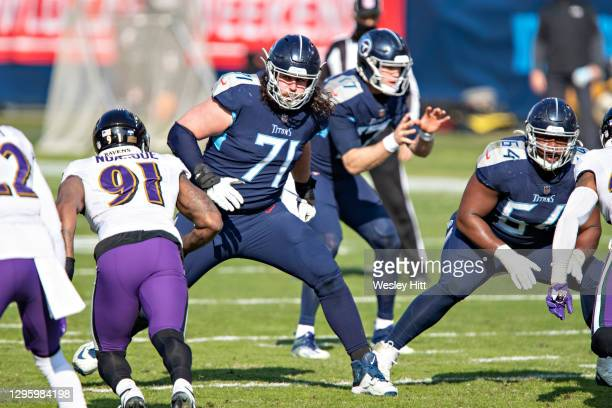 Tackle Dennis Kelly of the Tennessee Titans drops back to block during their AFC Wild Card Playoff game against the Baltimore Ravens at Nissan...