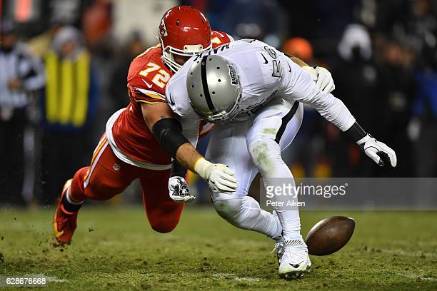 Tackle Eric Fisher of the Kansas City Chiefs stops defensive end Khalil Mack of the Oakland Raiders from recovering a caused fumble at Arrowhead...