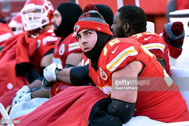 Tackle Eric Fisher of the Kansas City Chiefs watches the scoreboard from the bench during the game Tennessee Titans at Arrowhead Stadium on December...
