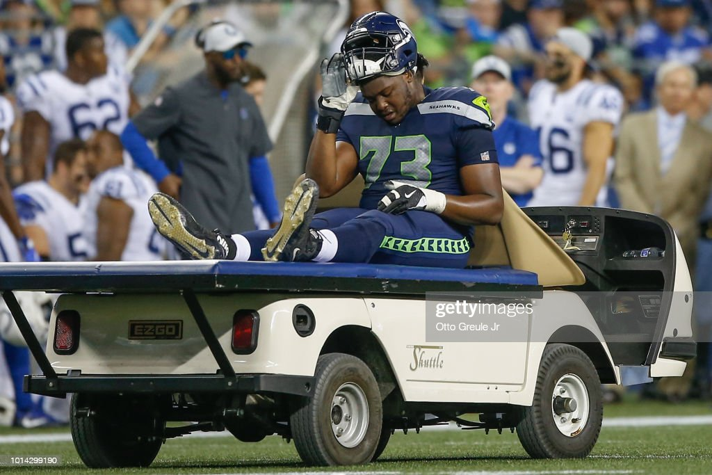 Tackle Jamarco Jones #73 of the Seattle Seahawks leaves the game with an injury against the Indianapolis Colts at CenturyLink Field on August 9, 2018 in Seattle, Washington.