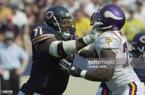 Tackle James Williams of the Chicago Bears blocks defensive end Kenny Mixon of the Minnesota Vikings during the NFL game at Memorial Stadium at the...
