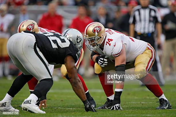 Tackle Joe Staley of the San Francisco 49ers prepares to block against the Oakland Raiders in the third quarter on December 7 2014 at Oco Coliseum in...