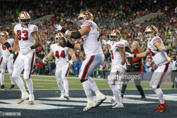 Tackle Joe Staley of the San Francisco 49ers spikes the ball after running back Raheem Mostert scored a touchdown in the fourth quarter against the...
