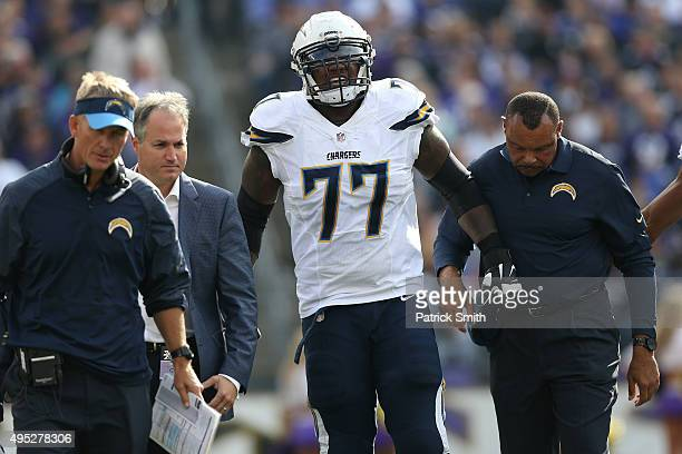 Tackle King Dunlap of the San Diego Chargers walks to the sideline after being injured against the Baltimore Ravens during the first half at M&T Bank...