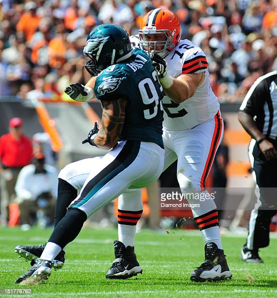 Tackle Mitchell Schwartz of the Cleveland Browns blocks defensive linemen Jason Babin of the Philadelphia Eagles during a game with the Philadelphia...
