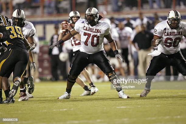 Tackle Na'Shan Goddard of the South Carolina Gamecocks blocks against the Missouri Tigers during the Independence Bowl on December 30, 2005 at...