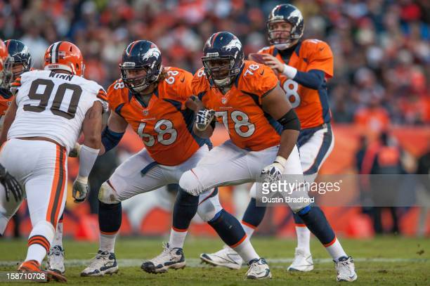 Tackle Ryan Clady and guard Zane Beadles of the Denver Broncos block for their quarterback during a game against the Cleveland Browns at Sports...