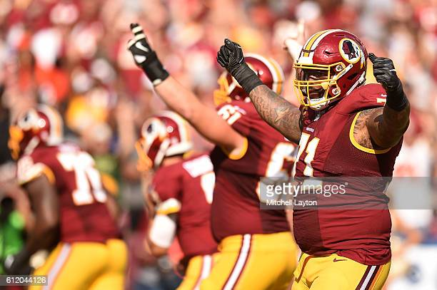 Tackle Trent Williams of the Washington Redskins acknowledges the crowd in the fourth inning against the Cleveland Browns at FedExField on October 2...