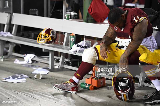 Tackle Trent Williams of the Washington Redskins shows his emotion after losing to the New York Giants at FedExField on September 25 2014 in Landover...