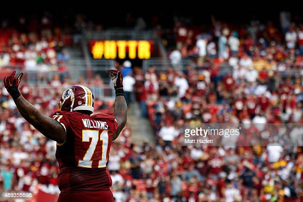 Tackle Trent Williams of the Washington Redskins signals to the crowd in the fourth quarter during a game against the St Louis Rams at FedExField on...