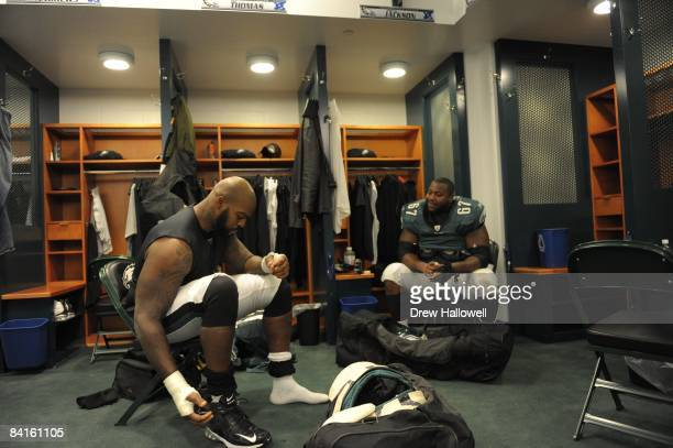 Tackle William Thomas and offensive lineman Jamaal Jackson of the Philadelphia Eagles sit in the locker room after game against the Dallas Cowboys on...