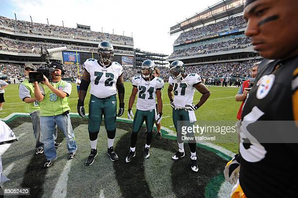 Tackle William Thomas, cornerback Joselio Hanson and safety Quintin Mikell of the Philadelphia Eagles stand for the coin toss during the game against...