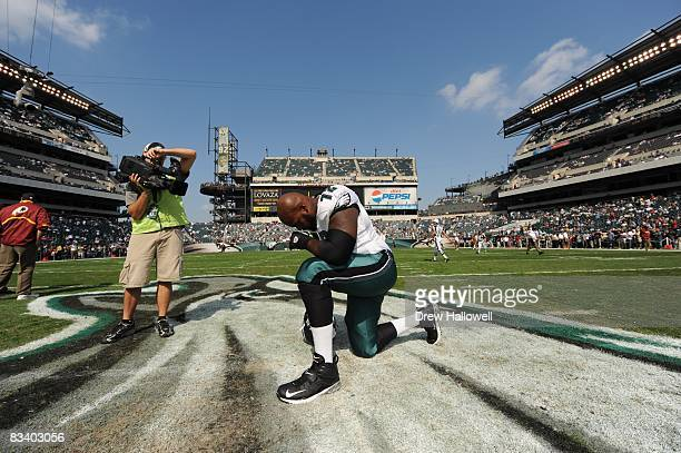 Tackle William Thomas of the Philadelphia Eagles prays before the game against the Washington Redskins on October 5 2008 at Lincoln Financial Field...
