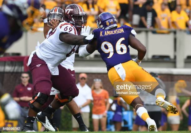 Tackle Yosuah Nijman of the Virginia Tech Hokies blocks defensive end Kiante Anderson of the East Carolina Pirates in the first half at DowdyFicklen...