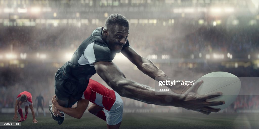 Tackled Rugby Player In Mid Air About To Score Try : Stock Photo
