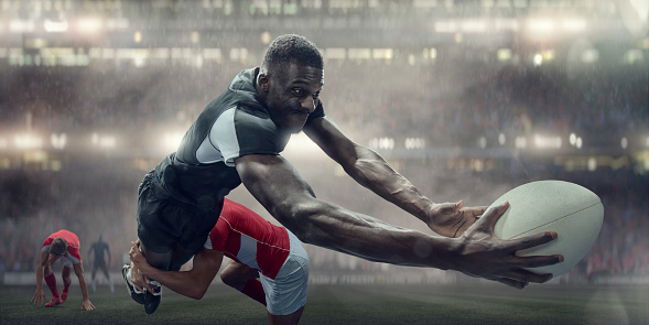 Tackled Rugby Player In Mid Air About To Score Try 996757188