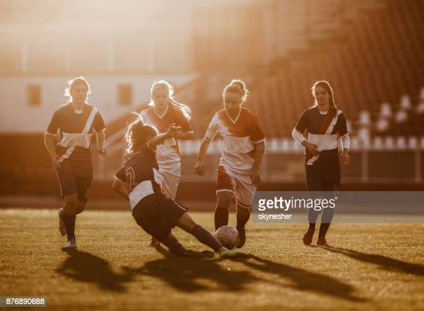 Tackling the rival on woman's soccer match!