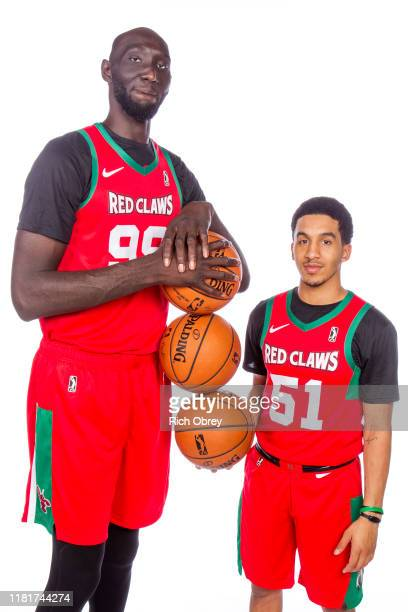 Tacko Fall and Tremont Waters of the Maine Red Claws pose for a portrait during Media Day on October 31 2019 at the Portland Expo in Portland Maine...