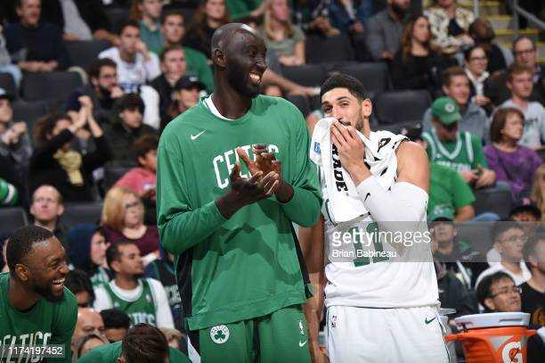 Tacko Fall of the Boston Celtics and Enes Kanter of the Boston Celtics shares a laugh during the game against the Charlotte Hornets on October 6 2019...