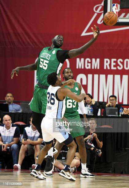 Tacko Fall of the Boston Celtics blocks a shot by Keenan Evans of the Memphis Grizzlies during the 2019 NBA Summer League at the Thomas Mack Center...