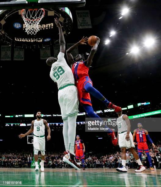 Tacko Fall of the Boston Celtics defends a shot from Thon Maker of the Detroit Pistons at TD Garden on December 20, 2019 in Boston, Massachusetts....