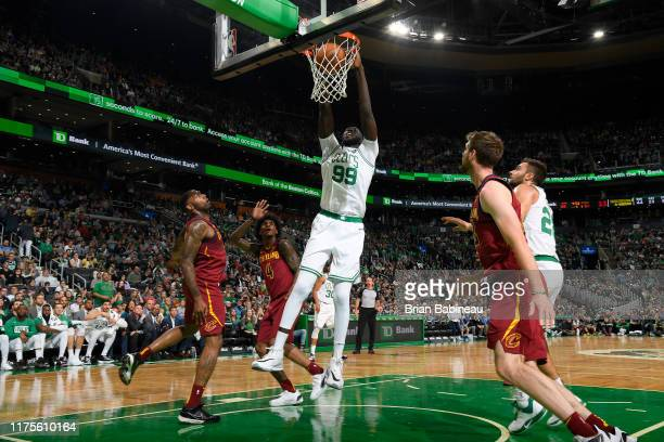 Tacko Fall of the Boston Celtics dunks the ball against the Cleveland Cavaliers during a preseason game on October 13 2019 at the TD Garden in Boston...