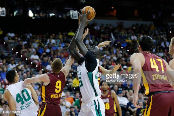 Tacko Fall of the Boston Celtics grabs a rebound against the Cleveland Cavaliers during the 2019 NBA Summer League at the Thomas Mack Center on July...