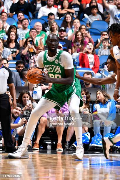 Tacko Fall of the Boston Celtics handles the ball against the Orlando Magic during a preseason game on October 11 2019 at Amway Center in Orlando...