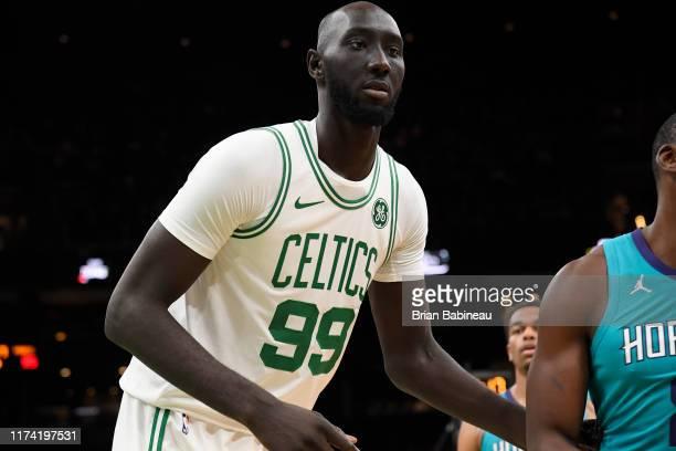 Tacko Fall of the Boston Celtics looks on during the game against the Charlotte Hornets on October 6 2019 at the TD Garden in Boston Massachusetts...