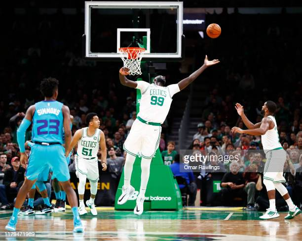 Tacko Fall of the Boston Celtics rebounds during the fourth quarter of the game against the Charlotte Hornets at TD Garden on October 06 2019 in...