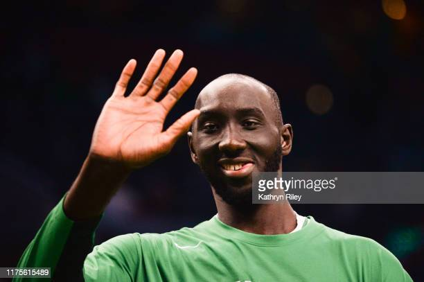 Tacko Fall of the Boston Celtics waves during warmups prior to the start of the game against the Cleveland Cavaliers at TD Garden on October 13 2019...