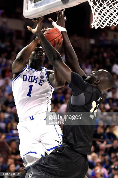 Tacko Fall of the Central Florida Knights defends a shot by Zion Williamson of the Duke Blue Devils in the first half during the second round of the...
