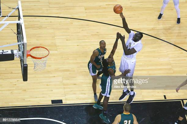 Tacko Fall of the UCF Knights attempts a shot over Keith Charleston and Joshua Filmore of the Southeastern Louisiana Lions during a NCAA basketball...