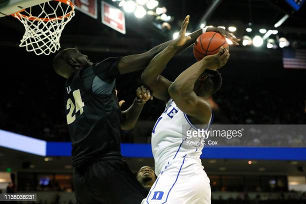 Tacko Fall of the UCF Knights blocks Zion Williamson of the Duke Blue Devils during the second half in the second round game of the 2019 NCAA Men's...