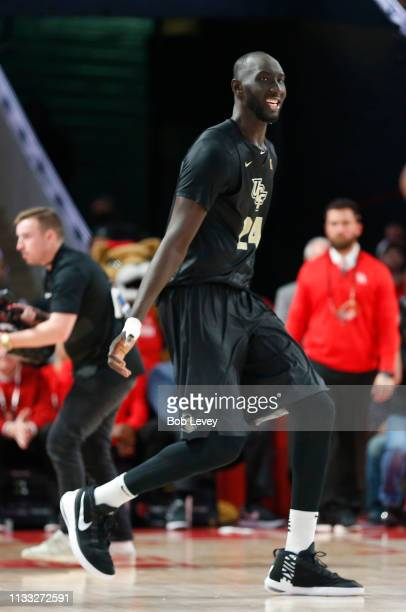 Tacko Fall of the UCF Knights celebrates after defeating the Houston Cougars 6964 at Fertitta Center on March 02 2019 in Houston Texas