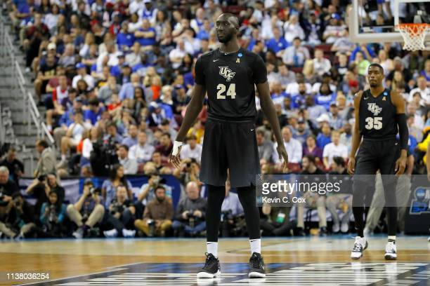 Tacko Fall of the UCF Knights looks on against the Duke Blue Devils during the first half n the second round game of the 2019 NCAA Men's Basketball...