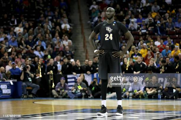 Tacko Fall of the UCF Knights looks on against the Virginia Commonwealth Rams in the first half during the first round of the 2019 NCAA Men's...