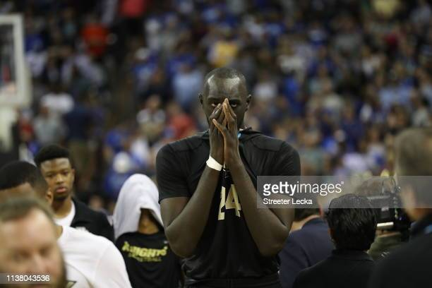 Tacko Fall of the UCF Knights reacts after being defeated by the Duke Blue Devils in the second round game of the 2019 NCAA Men's Basketball...
