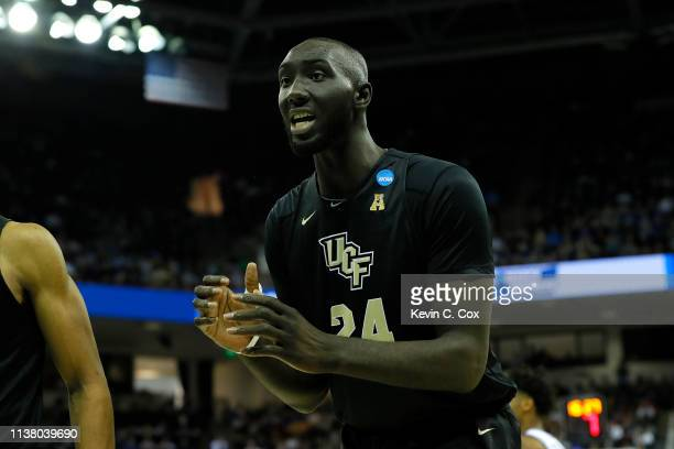 Tacko Fall of the UCF Knights reacts against the Duke Blue Devils during the second half in the second round game of the 2019 NCAA Men's Basketball...