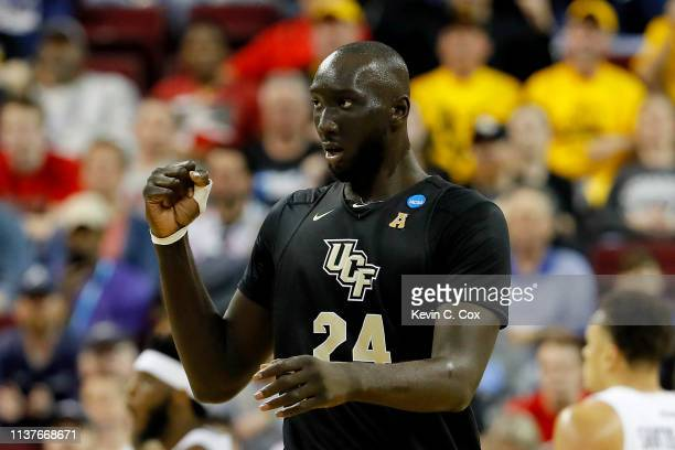 Tacko Fall of the UCF Knights reacts against the Virginia Commonwealth Rams in the first half during the first round of the 2019 NCAA Men's...