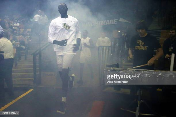 Tacko Fall of the UCF Knights runs through smoke onto the court prior to an NCAA basketball game against the Missouri Tigers at the CFE Arena on...