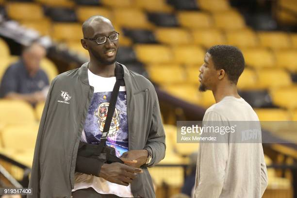 Tacko Fall of the UCF Knights speaks with Collin Smith of the UCF Knights during a NCAA basketball game between the SMU Mustangs and the UCF Knights...