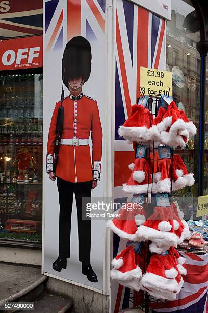 Tacky Christmas tourist trinkets with santa hat and grenadier soldier on sale outside a discount shop in New Oxford Street in central London There...