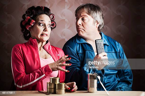 tacky retro person in tracksuit eating canned food. - miserly stock pictures, royalty-free photos & images