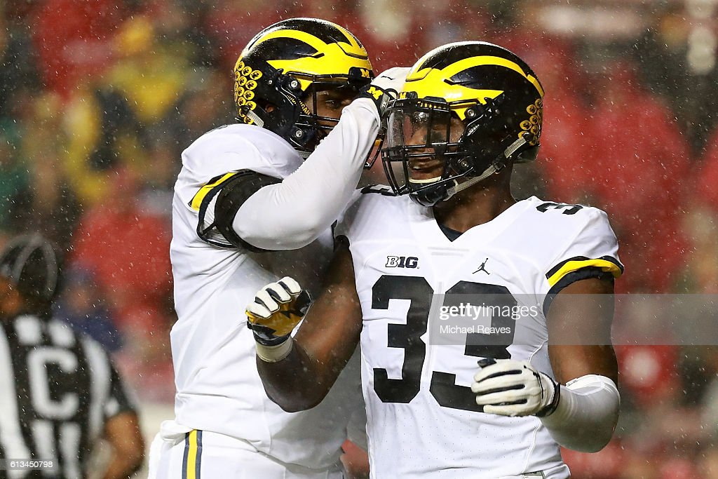 Taco Charlton #33 of the Michigan Wolverines celebrates with his teammate after a sack during the first half against Rutgers Scarlet Knights at High Point Solutions Stadium on October 8, 2016 in Piscataway, New Jersey.