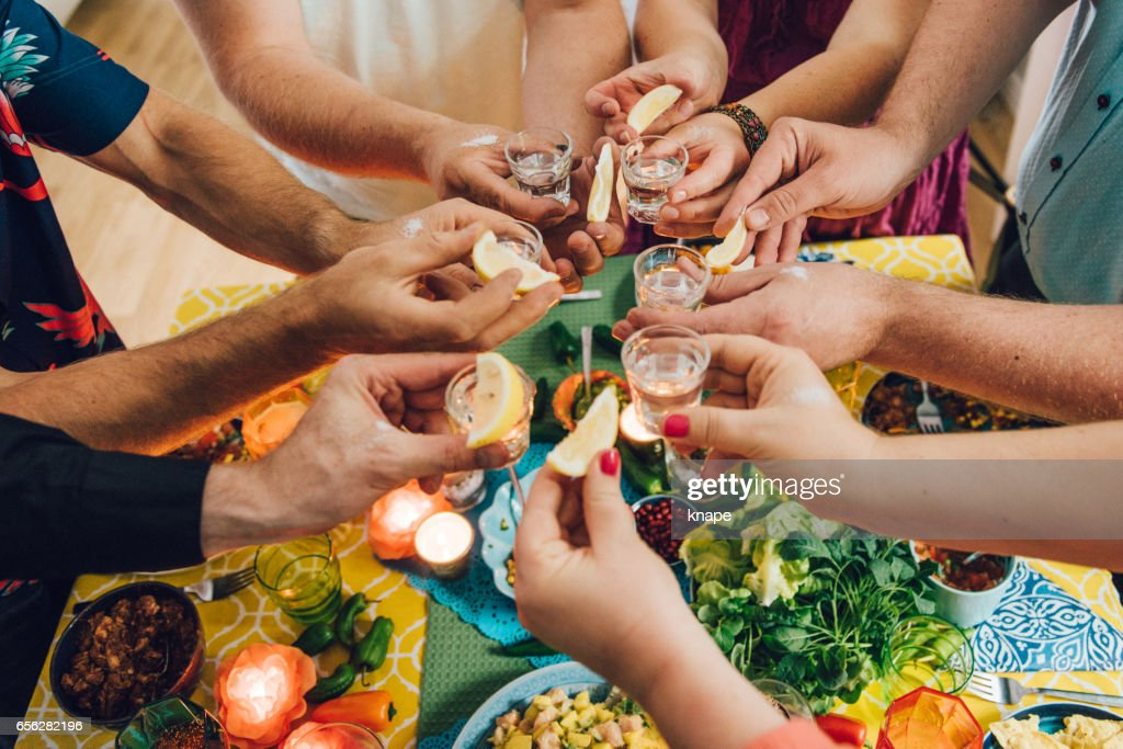 Taco Mexican tex med food lifestyles with friends having tequila : Stock Photo